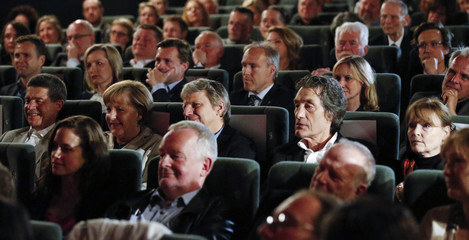 "German Chancellor Merkel, her husband, German director Dresen, and actors Glatzeder and Domroese wait for the screening of ""The Legend of Paul and Paula"" at a cinema in Berlin"