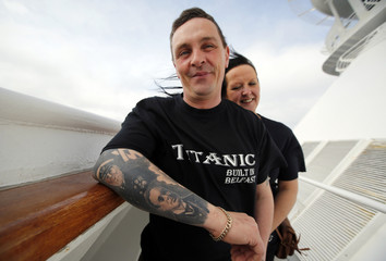 Derek Chambers of Belfast shows off tattoos of Titanic's crew while onboard the Titanic Memorial Cruise in the mid-Atlantic Ocean