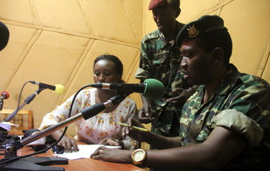 Major General Niyombare addresses the nation inside the RPA broadcasting studios in Burundi's capital Bujumbura