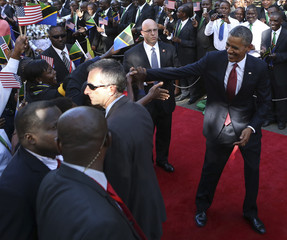 U.S. President Obama is greeted during an official arrival ceremony in Dar Es Salaam