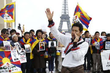 Pro-Tibet activists attend a demonstration in front of the Eiffel tower in Paris