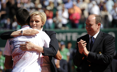 Princess Charlene of Monaco hugs Djokovic after the finals of the Monte Carlo Tennis Masters in Monaco