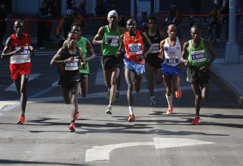 2011 New York City Marathon winner Geoffrey Mutai of Kenya runs with the leaders during the 2011 New York City Marathon in New York