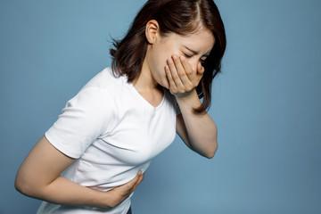 Obraz young woman feeling nauseated. - fototapety do salonu