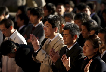 People pray at the start of the new business year at Kanda Myojin Shrine in Tokyo