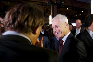 Volkswagen CEO Mueller mingles at their media reception during the North American International Auto Show in Detroit