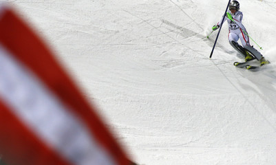 Hosp from Austria passes a gate during the Alpine Skiing World Cup night slalom race in Flachau