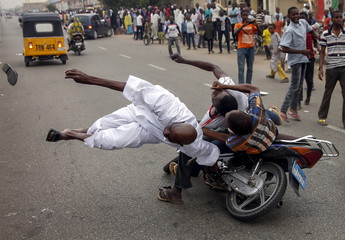 Two supporters of the presidential candidate Muhammadu Buhari and his All Progressive Congress party accidentally hit another supporter with their motorbike during celebrations in Kano