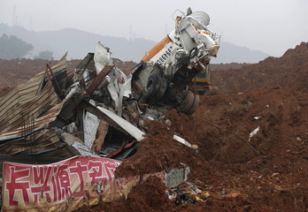 A damaged cement mixer truck is seen in the industrial park hit by a landslide in Shenzhen