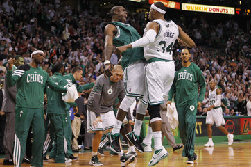 Boston Celtics' Pietrus and Pierce bump chests during Game 1 of their NBA Eastern Conference semi-final playoff against Philadelphia 76ers in Boston