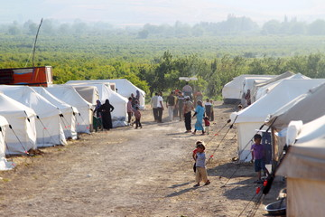 People are seen inside a camp for internally displaced persons near the Syrian Turkish border in Salqin, Idlib countryside, Syria
