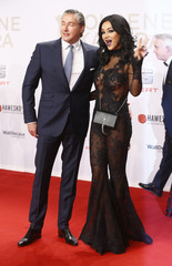TV presenter Pooth and husband Franjo arrive on red carpet for Golden Camera awards ceremony in Hamburg