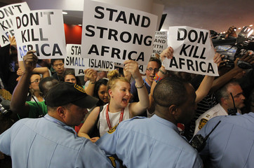 Protesting environmental activists attempt to gain access to the plenary session of the United Nations Climate Change Conference