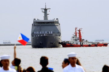 A Philippine Navy's first Strategic Sealift Vessel Tarlac slowly docks during the ceremonial arrival at Pier 13 of Manila South Harbour