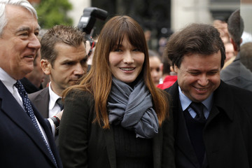 France's First lady Carla Bruni-Sarkozy arrives at a polling station during the second round of 2012 French presidential election in Paris