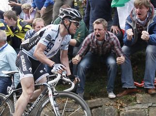 Saxo Bank-Sungard's Nick Nuyens of Belgium climbs the Geraardsbergen wall during the ProTour Ronde van Vlaanderen/Tour of Flanders cycling race in Meerbeke
