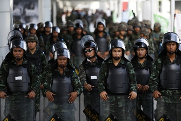 Soldiers block the entrance to an elevated train station near a shopping mall where anti-coup protesters gather in Bangkok