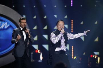 Ryan Seacrest and singer William Hung appear on stage during the American Idol Grand Finale in Hollywood