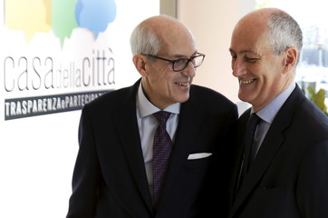 Prefect of Milan and new commissioner of Rome Tronca and government prefect Gabrielli talk during a news conference in Rome