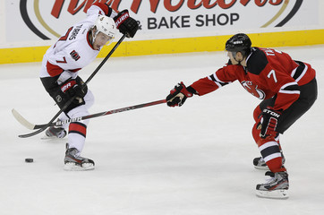 Ottawa Senators' Turris reacts as New Jersey Devils' Tallinder pokes the puck away from him during their NHL hockey game in Newark