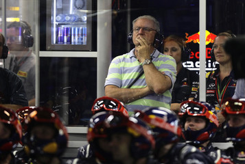 Alan Webber watches his son Red Bull Formula One driver Mark Webber of Australia race from the pit during the Singapore F1 Grand Prix at the Marina Bay street circuit in Singapore