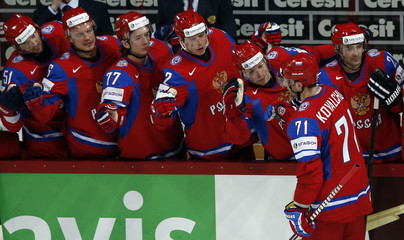 Russia's Ilya Kovalchuk (71) celebrates with his teammates on the bench after scoring against Team USA during their 2013 IIHF Ice Hockey World Championship preliminary round match at the Hartwall Arena in Helsinki