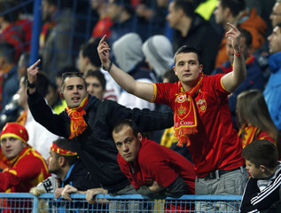Montenegro fans gesture towards the England fans during the 2014 World Cup qualifying soccer match between Montenegro and  England at the City Stadium in Podgorica