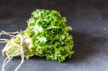 Lettuce on dark marble background horizontally