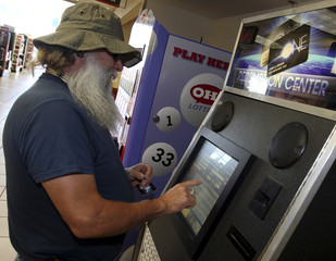 Truck driver Toney Murr works on his rewards account at a kiosk located inside a TA Truck stop in Lodi, Ohio