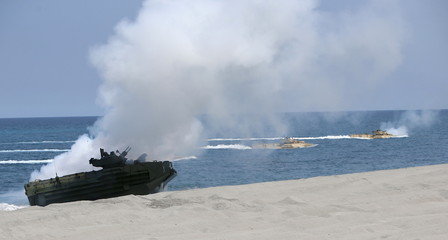 """U.S. military forces aboard Amphibious Assault Vehicles perform beach landing at shore of San Antonio, Zambales during the annual """"Balikatan"""" war games with Filipino soldiers"""