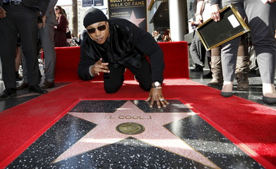 Hip hop recording artist LL Cool J touches his star after it was unveiled on the Hollywood Walk of Fame in Los Angeles