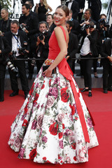 """Fashion blogger Natalia Shustova poses on the red carpet as she arrives for the screening of the film """"Sicario"""" in competition at the 68th Cannes Film Festival in Cannes"""