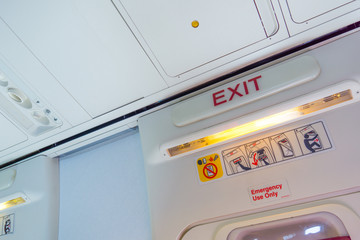Exit sign and symbols in an aircraft cabin