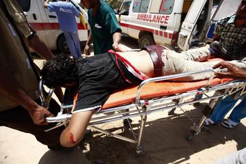 Medics wheel an injured rebel fighter at a field hospital near Misrata's western front line