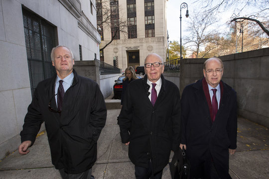 Rupert Murdoch, the chairman of News Corp and 21st Century Fox, arrives at New York State Supreme Court with his lawyers in New York