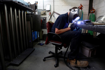 Welder Sean Johnson welds at Contracts Engineering Ltd, a steel products manufacturer, in Sittingbourne