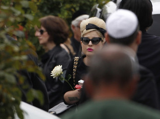 Kelly Osbourne arrives at the funeral service for Amy Winehouse at a cemetery in north London