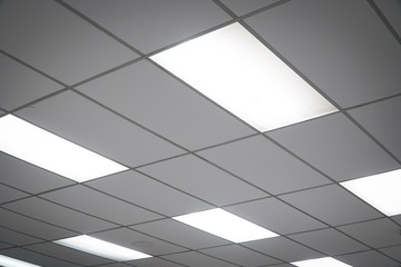 White ceiling with neon light bulbs in uprisen view