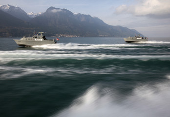 Swiss army boats are pictured on Lake Leman during transport for a presentation ahead of the Francophone Summit near Montreux