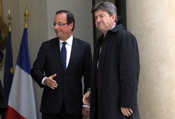 French President Hollande speaks with Parti de Gauche party leader Melenchon following a meeting at the Elysee Palace in Paris