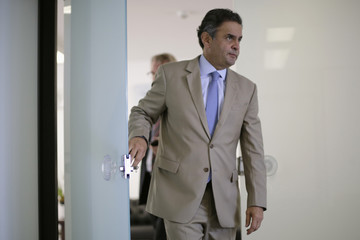 President of the opposition Brazilian Social Democracy Party (PSDB) Aecio Neves arrives for an interview with Reuters at the Senate in Brasilia