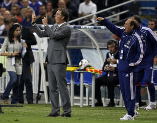 France's coach Laurent Blanc directs his players during  their Euro 2012 qualifying soccer match against Belarussia in Saint-Denis
