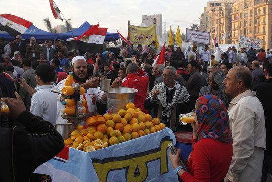 Street vendor sells orange juice as anti-Mursi protesters gather in Tahrir Square in Cairo