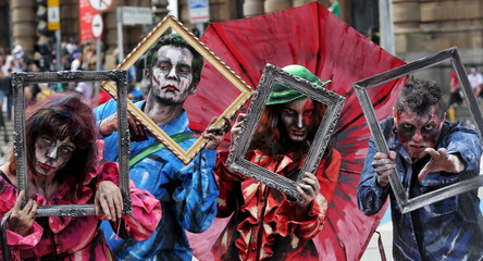 """Revellers with their bodies and faces painted attend the """"Zombie Walk"""" parade in Sao Paulo, Brazil"""