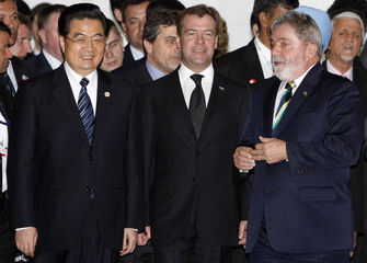 China's President hu, Russia's President Medvedev and Brazil's President Lula arrive to attend photocall at Itamaraty Palace in Brasilia