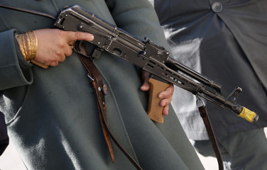 A female Afghan National Police officer holds her weapon during a drill at a training centre near the German Bundeswehr army camp Marmal in Mazar-e-Sharif