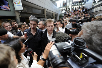 France 3 television journalists Ghesquiere and Taponier speak during a gathering to celebrate their arrival at France Television headquarters in Paris