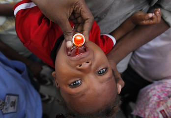 A Haitian child takes medicine at the Gheskio Hospital in Port-au-Prince