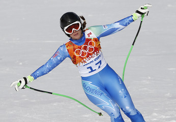 Slovenia's Tina Maze reacts in the finish area after competing during the downhill run of the women's alpine skiing super combined event during the 2014 Sochi Winter Olympics