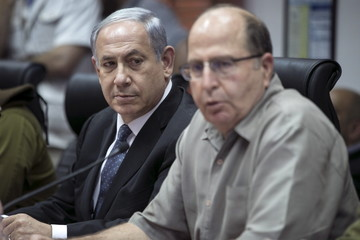 Israel's Prime Minister Netanyahu attends a briefing at the Israeli army's Home Front Command base in Ramle
